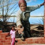 Standing at the mural at the Harriet Tubman Museum in Cambridge MD. She she was born in Dorchester County in March 1842